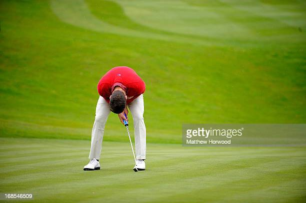 Gethin Jones shows his frustration after missing a putt at the Celebrity Golf Club Live event at Celtic Manor Resort on May 11, 2013 in Newport,...
