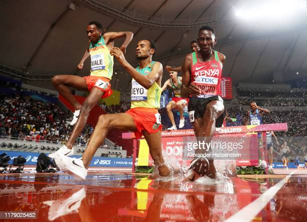 Getnet Wale of Ethiopia, Chala Beyo of Ethiopia and Conseslus Kipruto of Kenya compete in the Men's 3000 metres Steeplechase final during day eight...