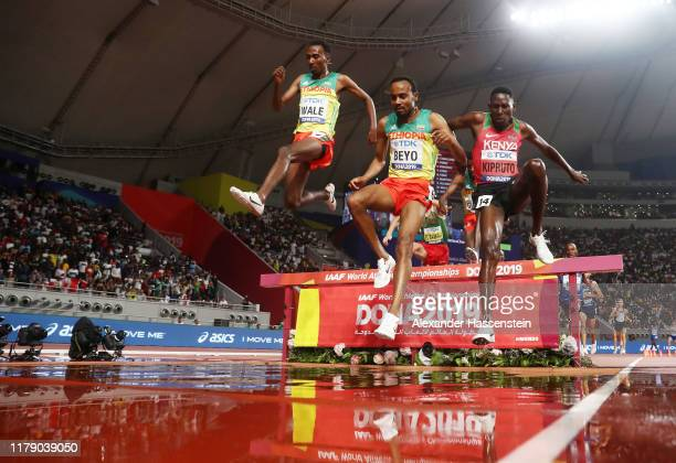 Getnet Wale of Ethiopia, Chala Beyo of Ethiopia and Conseslus Kipruto of Kenya clear the water jump as they compete in the Men's 3000 metres...