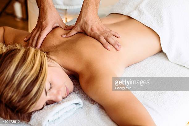 getting a massage - massage therapist stock pictures, royalty-free photos & images