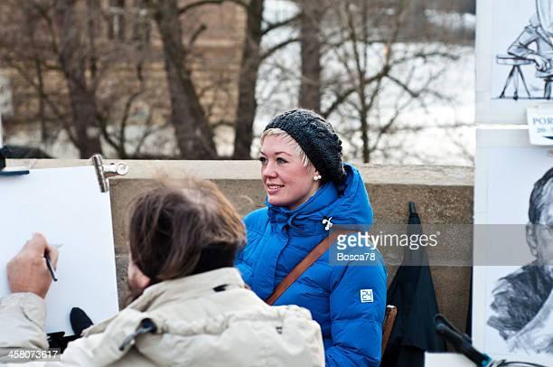 Getting a portrait on Charles Bridge in Prague