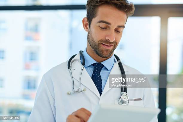 getting a second opinion online - handsome doctors stock pictures, royalty-free photos & images