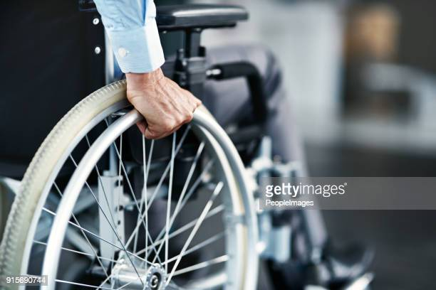getting around - wheelchair stock pictures, royalty-free photos & images