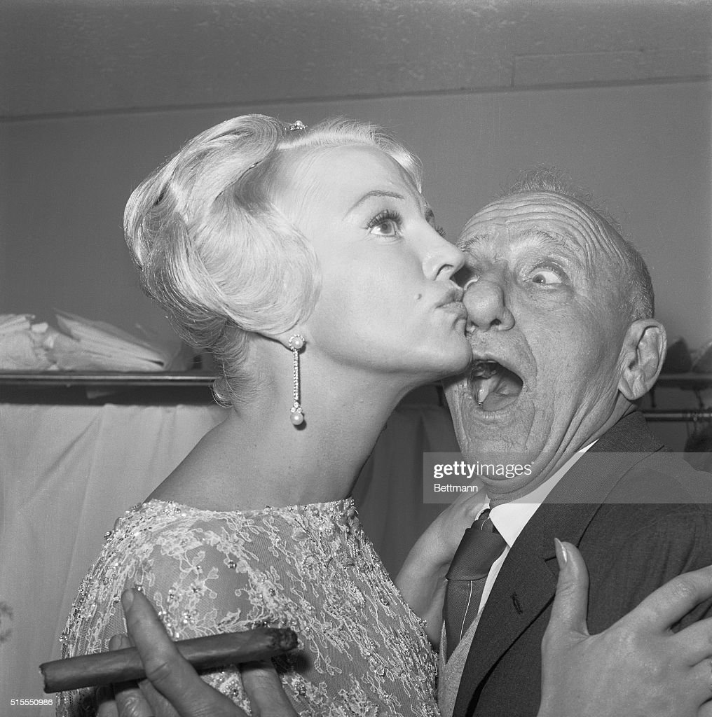 Getting busted in the nose is nothing to sniff about, says Jimmy Durante, whose considerable schnozzle is smacked by shapely song star Peggy Lee. Both headliners are appearing in New York nightclubs: Jimmy at the Copecabana and Peggy at Basin Street East.
