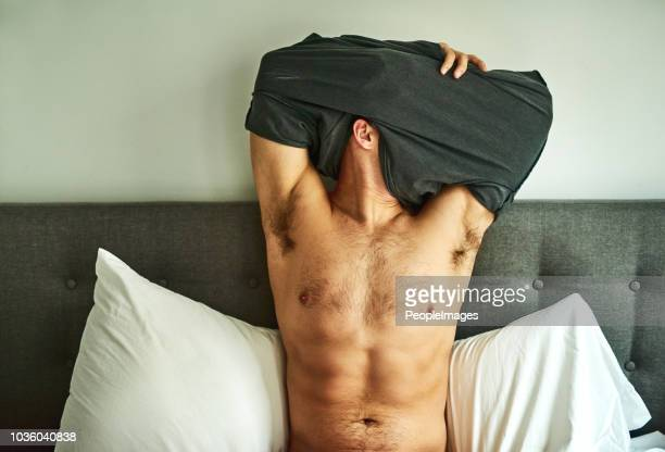 getting comfy for bed - hairy man stock pictures, royalty-free photos & images