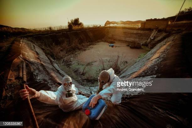 getting contaminated water to drink - dystopia - kontaminierung stock-fotos und bilder