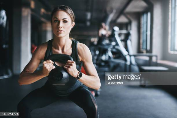 getting fit one lift at a time - gym stock pictures, royalty-free photos & images