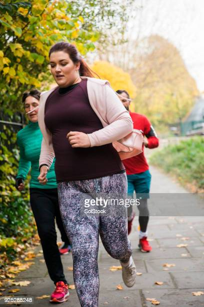An Overweight Female Jogging