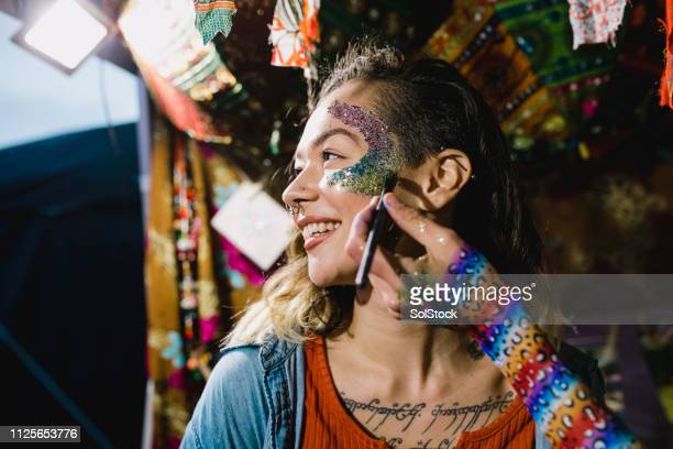 getting glittery for the festival - stage make up stock pictures, royalty-free photos & images