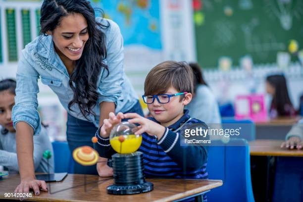 getting help from teacher - elementary age stock pictures, royalty-free photos & images