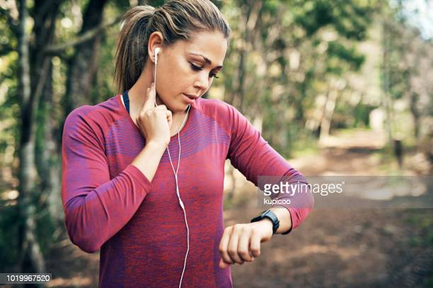 getting her heart rate up - checking sports stock pictures, royalty-free photos & images