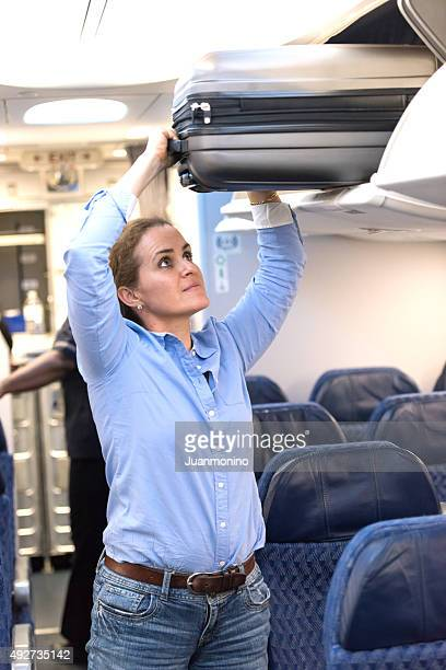 Getting her suitcase out of the luggage compartment