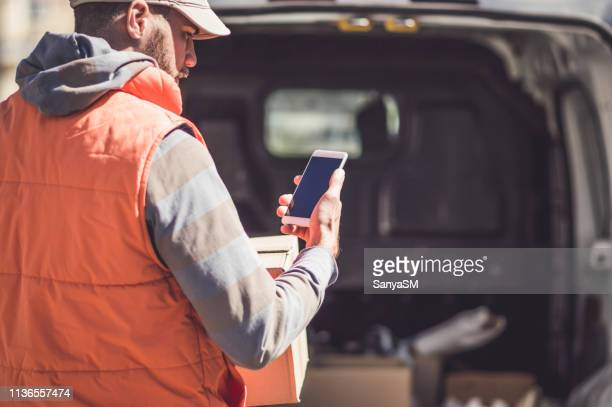 getting his deliveries out - delivery person stock pictures, royalty-free photos & images