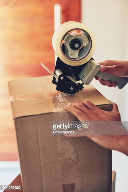 getting it all boxed up - tape dispenser stock photos and pictures