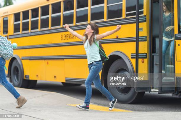 getting off the school bus - first day of school stock pictures, royalty-free photos & images