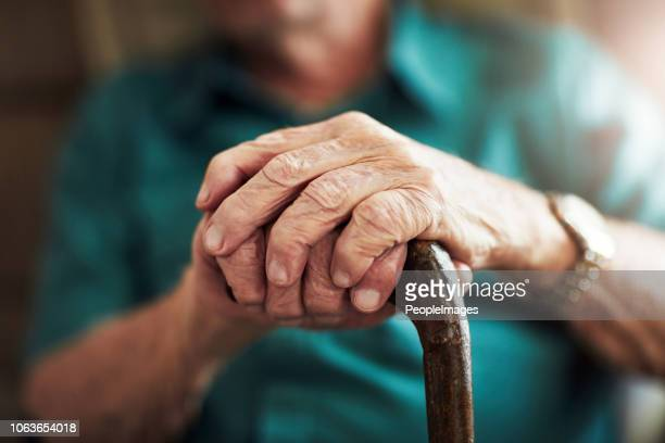 getting older can bring senior health challenges - walking cane stock pictures, royalty-free photos & images