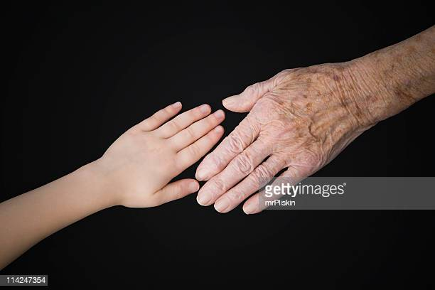 getting older – young and old hands - liver spot stock photos and pictures
