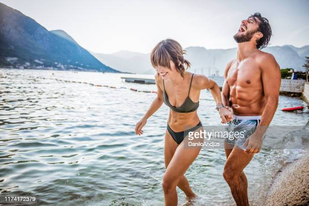 getting our dose of vitamin sea - swimwear stock pictures, royalty-free photos & images