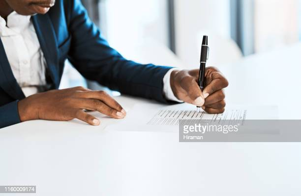 getting paperwork under control - questionnaire stock pictures, royalty-free photos & images