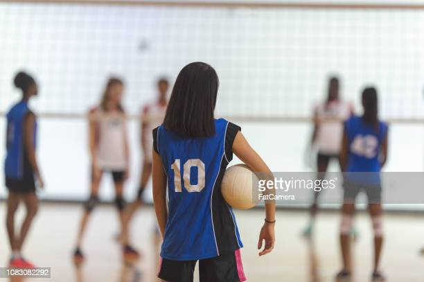getting ready for a match - high school volleyball stock photos and pictures
