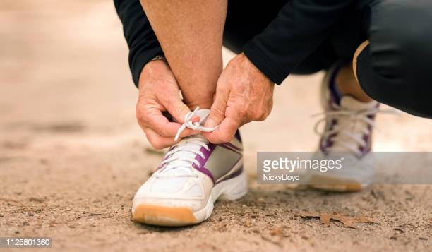 getting ready for a run - old lady feet stock pictures, royalty-free photos & images