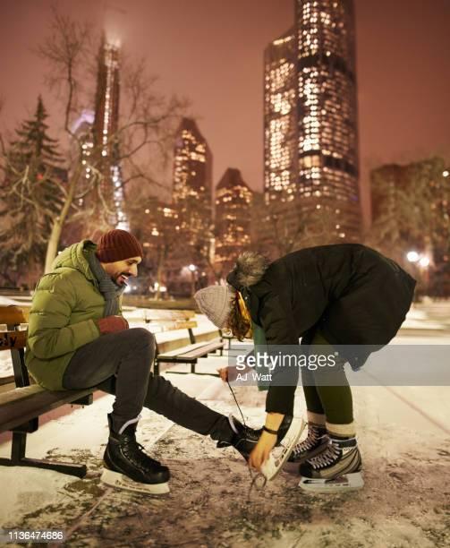 getting ready for ice skating - schaats ijs stockfoto's en -beelden
