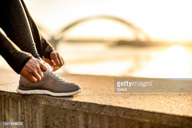 getting ready for running. - gray shoe stock pictures, royalty-free photos & images
