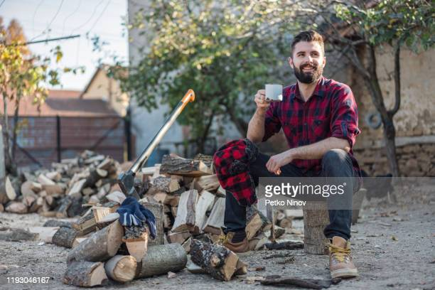 getting ready for winter - masculinity stock pictures, royalty-free photos & images