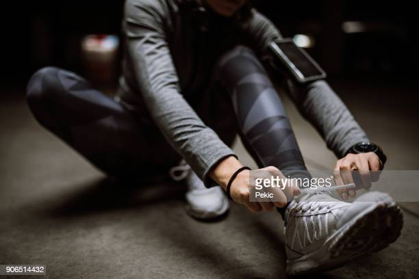 getting ready - tying shoelace stock pictures, royalty-free photos & images