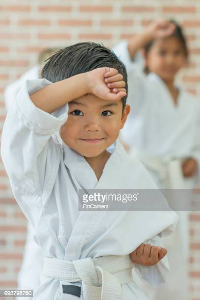 getting ready to fight! - taekwondo kids stock photos and pictures