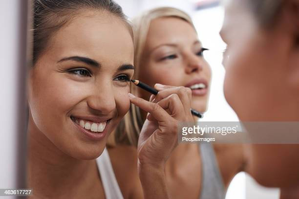 getting ready to go out - eye liner stock photos and pictures