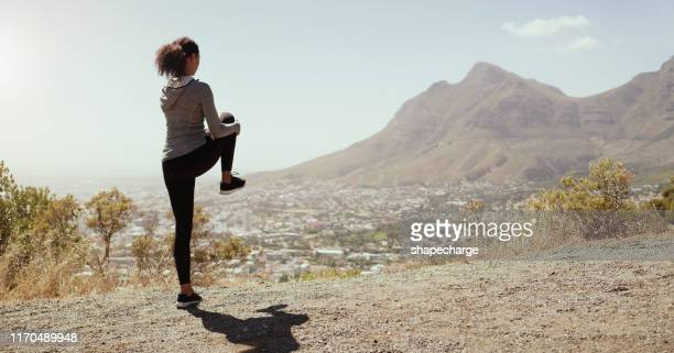 getting ready to meet her goals - standing on one leg stock pictures, royalty-free photos & images
