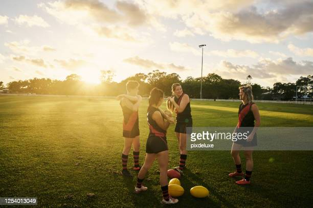 getting ready to play a good game - afl stock pictures, royalty-free photos & images