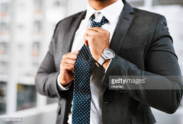 getting ready to play the business game - full suit stock pictures, royalty-free photos & images