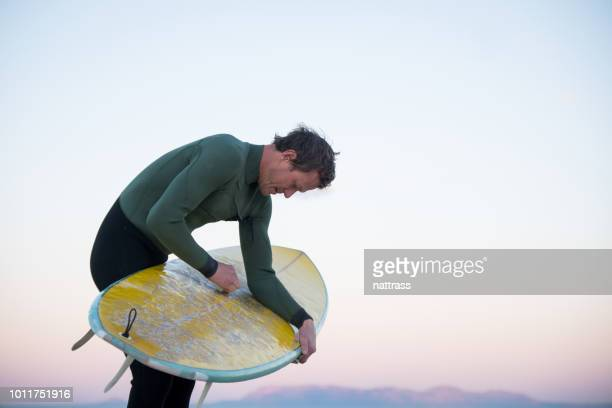 getting ready to surf - wax stock pictures, royalty-free photos & images