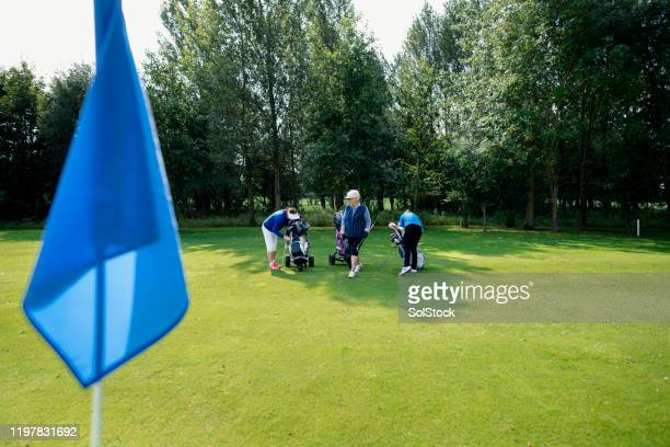 getting ready to tee off - golf stock pictures, royalty-free photos & images