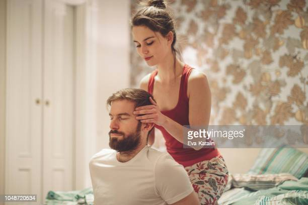 getting rid of headache - husband massage wife stock photos and pictures