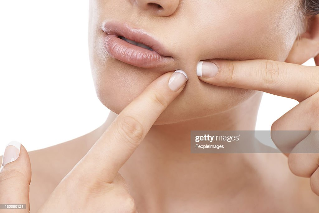 Getting rid of those imperfections... : Stock Photo