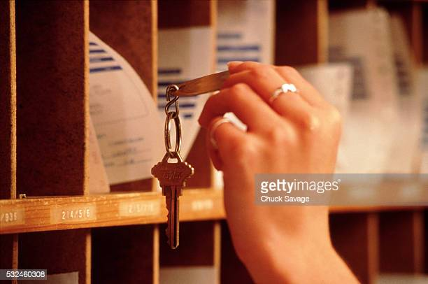 getting room key at inn - inn stock pictures, royalty-free photos & images