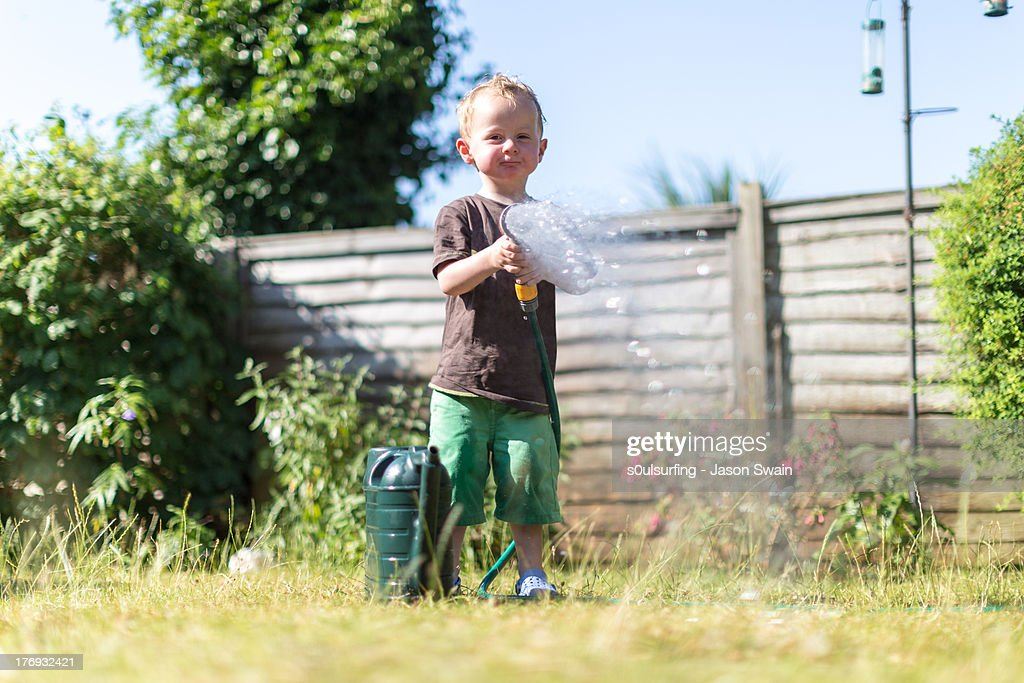 Getting soaked by a Toddler : Stock Photo
