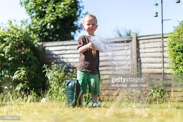 getting soaked by a toddler - s0ulsurfing stock pictures, royalty-free photos & images