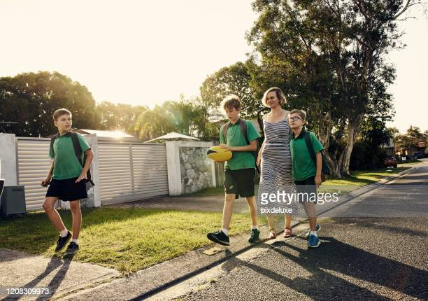 getting some exercise after school - education stock pictures, royalty-free photos & images