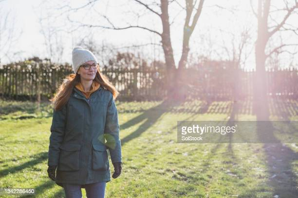 getting some fresh air on morning walk - cold temperature stock pictures, royalty-free photos & images