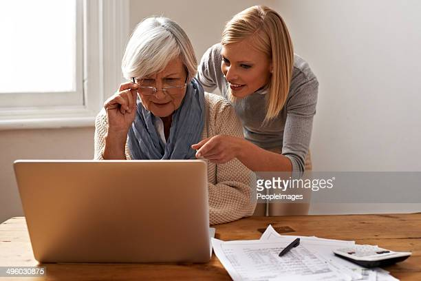 getting some help from her granddaughter to speed things along - doing a favor stock pictures, royalty-free photos & images