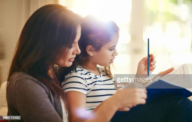 getting some homework done before playtime - workbook stock photos and pictures