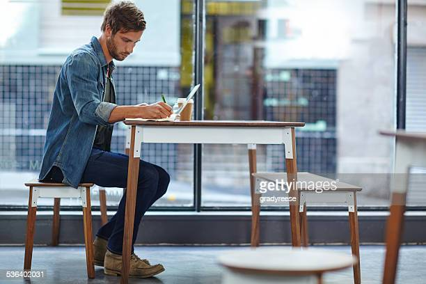 Getting some work done in his favorite cafe