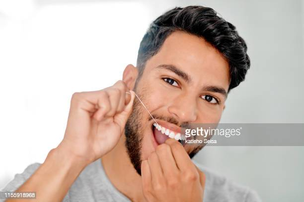 getting stuck in there - dental floss stock pictures, royalty-free photos & images
