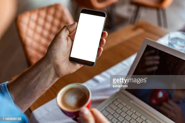 getting the most out of the work day with technology - iphone screen stock pictures, royalty-free photos & images