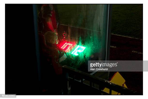 Getting the numbers board ready for a substitution during the Ryman Premier League match between Worthing FC and Staines Town FC at Woodside Road on...