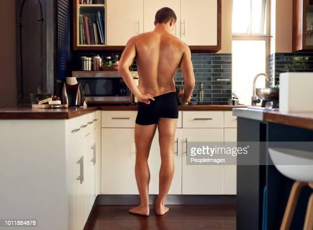 getting the preparations done in order to make breakfast - homem de cueca imagens e fotografias de stock